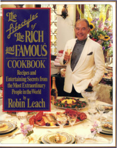 Cover of the book, The Lifestyles of the Rich and Famous Cookbook authored by Robin Leach, featuring recipes by Wolfgang Puck